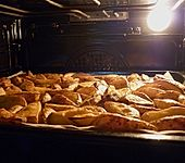 Country-Potatoes oder würzige Kartoffelspalten aus dem Ofen (Bild)