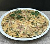Omelett mit gekochtem Schinken und Champignons (Bild)