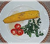 Maiskolben mit Butter (Bild)