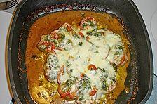 Schweinefilet mit Tomaten und Mozzarella überbacken