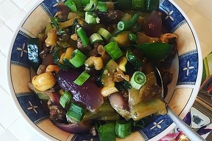 Chinesisches Rindfleisch mit Zwiebeln und Paprika 17