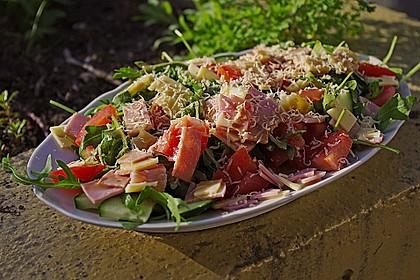 Rucolaplatte mit Tomaten und Gurken mit Balsamicodressing 0