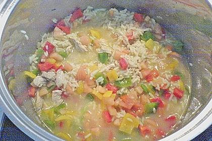 Reispfanne mit Fleisch und Scampi 1