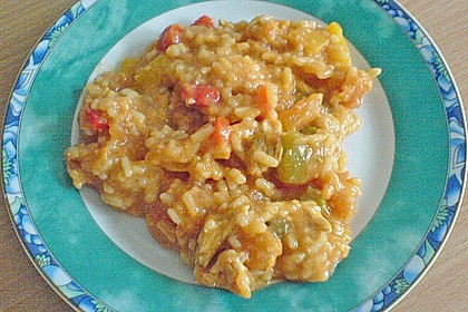 Reispfanne mit Fleisch und Scampi