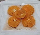 Orangenfilets in Safran-Gewürzsirup