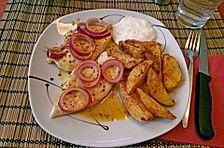 Putenschnitzel an Orangen-Pfeffer-Sauce mit Kartoffelecken in Knoblauch-Marinade