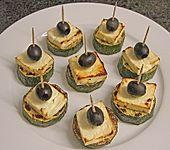 Zucchinischeiben mit Schafskäse überbacken (Bild)