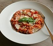 Reispfanne mit Tomaten und Pilzen