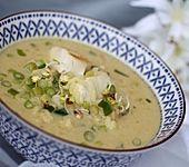 Kokossuppe mit Reis und Seelachs