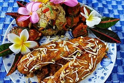 Pangasiusfilet im Mangobett mit Auberginen-Sambal und gebratenem Reis