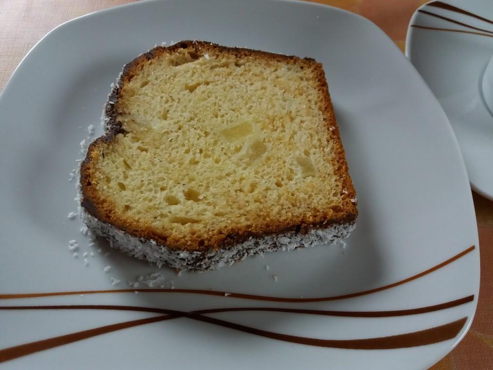 Kuchen mit schokoglasur und kokosraspeln