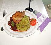 Kotelett mit Rotweinsoße und Tomaten