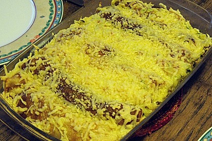 Überbackene Pfannkuchenrollen mit Spinatfüllung