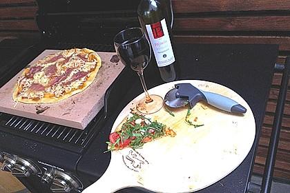 Pizza mit Rucola und Parmaschinken 1