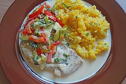 Putenmedaillons in cremiger Gemüsesauce mit Gelbreis 2