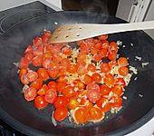 Garnelen in fruchtig, scharfer Sauce auf Nudeln (Bild)