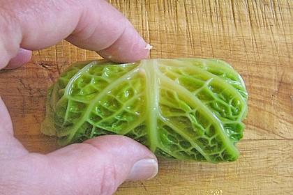 Schellfisch in Lachsfarce mit Wirsingmantel an Linsen und Pilzen in einer Sahnesauce 6