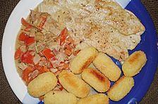 Putenschnitzel mit pikanter Sauce