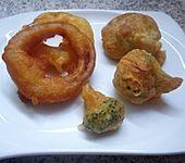Zwiebelringe und Brokkoli im Bierteig